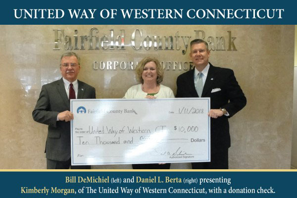 United Way of Western Connecticut - Bill DeMichael and Daniel L. Berta presenting Kimberly Morgan, of The United Way of Western Connecticut, with a donation check.